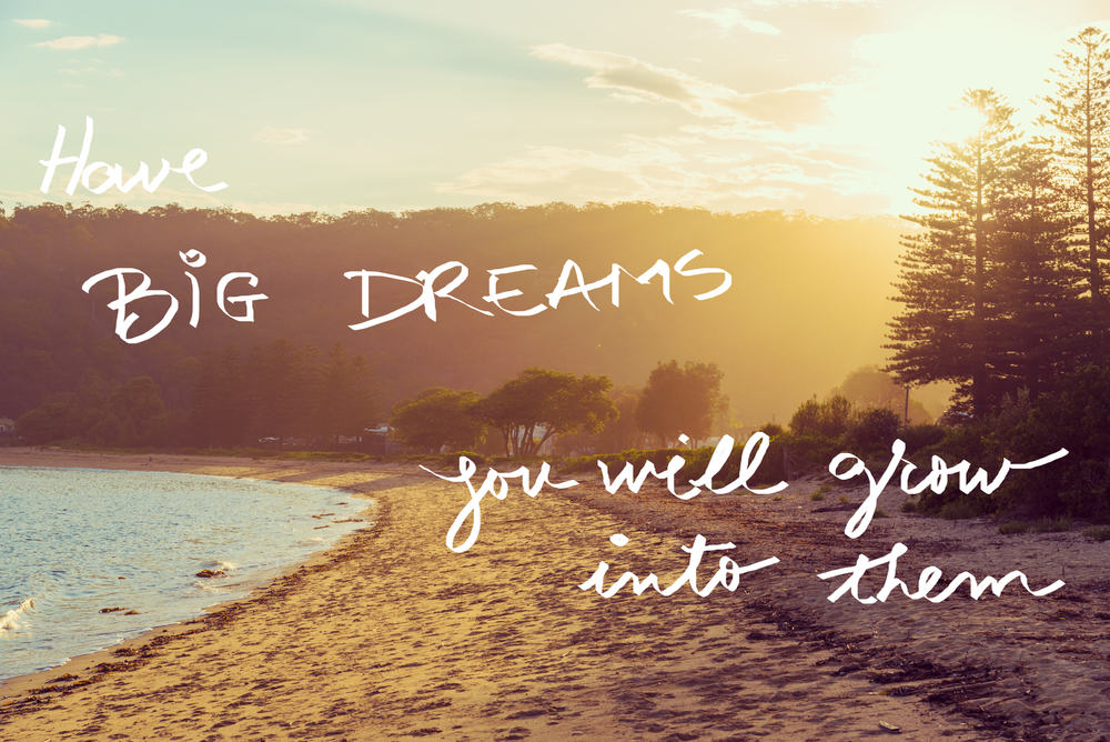 Handwritten text over sunset calm sunny beach background, HAVE BIG DREAMS YOU WILL GROW INTO THEM, vintage filter applied, motivational concept image